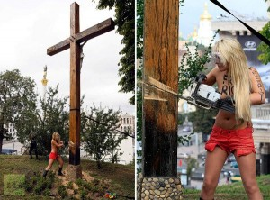 Topless Pussy Riot supporter taking down cross in Kiev