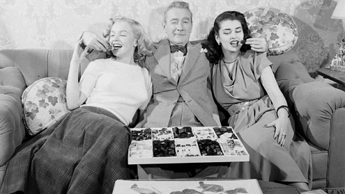 Clifton and the Gopis: Webb's Krishna-like attraction led the unknown starlet Marilyn Monroe onto the set of Sitting Pretty and thus into this Life photo-shoot.