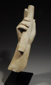 Life-size Roman marble forearm (from a statue) holding a portion of a baton