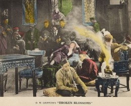 White woman lounging amidst Asian addicts in Limehouse opium den