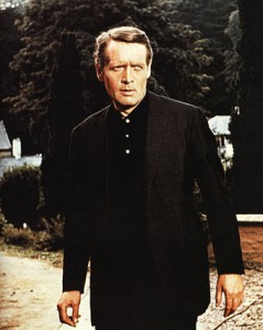"McGoohan wearing his modernized Brand costume in ""Arrival"""
