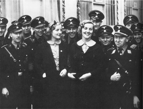 Unity (left) and Diana Mitford at a 1937 rally in Germany. While their perverse younger sister Jessica turned toward Jews and communism, Unity and Diana had a deep and sincere enthusiasm for the Western renaissance which blossomed in Germany under the guidance of Adolf Hitler. On the day that Churchill and his fellow conspirators forced Great Britain to declare war on Germany, the grief-stricken Unity fired a bullet into her brain.