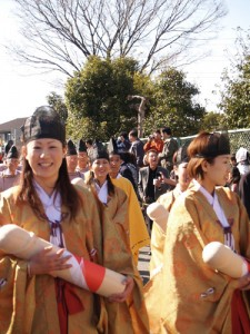 Women carry sacred phalluses, Shinto Honen-Sai Fertility Festival