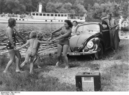 Pre-war German photo showing the People's radio and the People's car