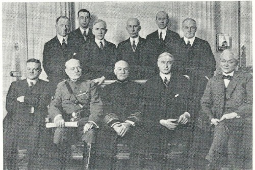 "ECONOMIC section of the American delegation to the Paris Peace Conference: Bernard Baruch is seated second from the right. Standing third from the right is ""Colonel"" Edward Mandel House."