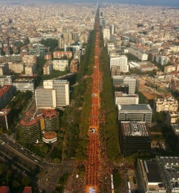 "View of one of the two 'legs' of a gigantic ""V"" (for 'Vote' and 'Victory') formed in Barcelona last Sept. 11, Catalonia's National Day. Demonstrators drew the Catalan flag: four red stripes on a yellow background."