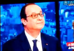 President of France after losing a four minute debate with Arab teenagers looks toward the pretty hostess to save him