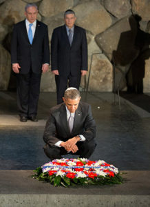 Barack Obama kneels reverently under the watchful eye of Benjamin Netanyahu at the Yad Vashem Holocaust memorial